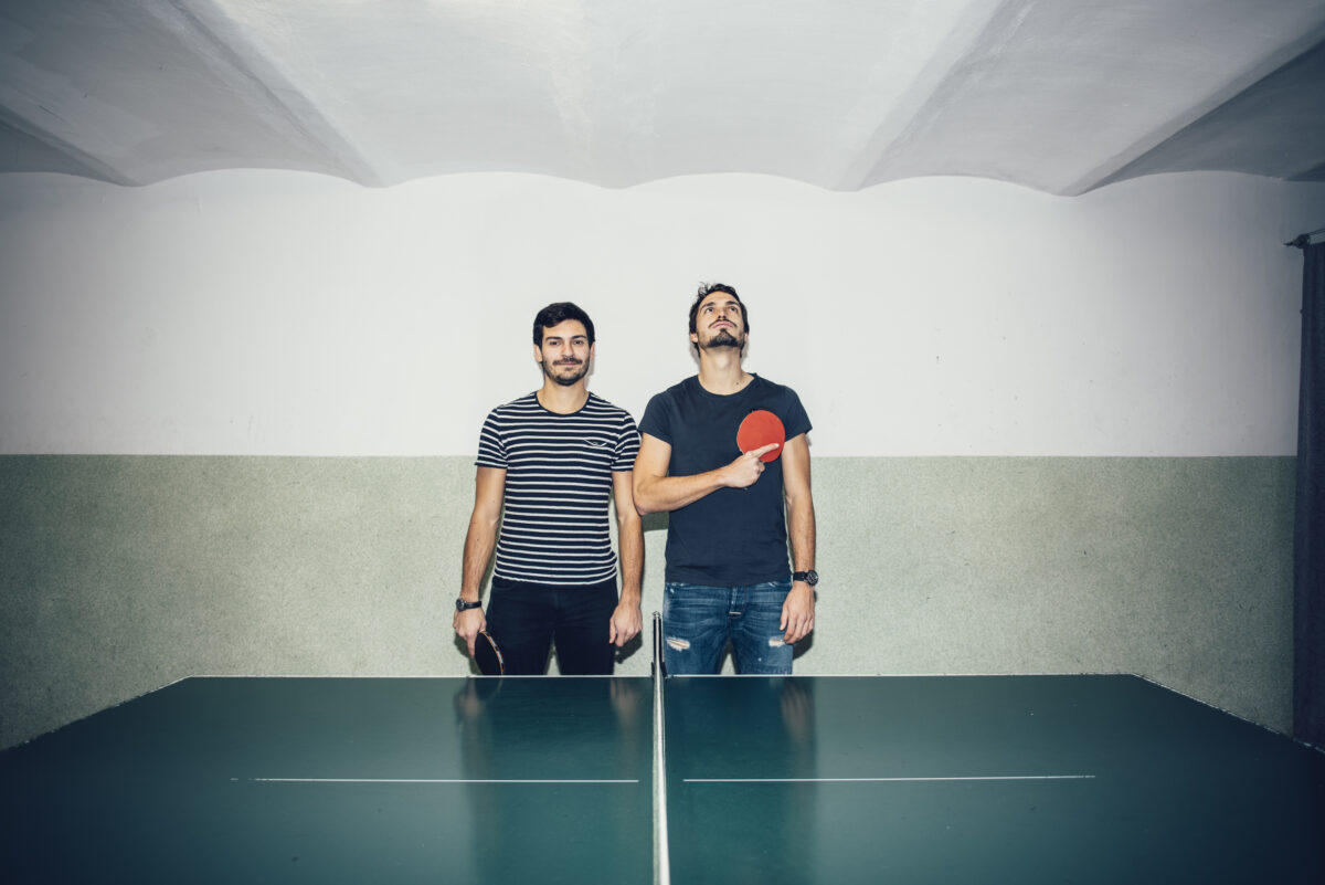 mats hummels and jonas humbles playing table tennis, by dirk bruniecki